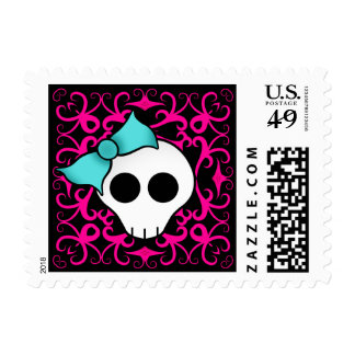 Gothic skull with blue blow on black and fuschia postage