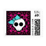 Gothic skull with blue blow on black and fuschia stamp