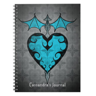 Gothic victorian staked vampire heart in blue spiral notebook