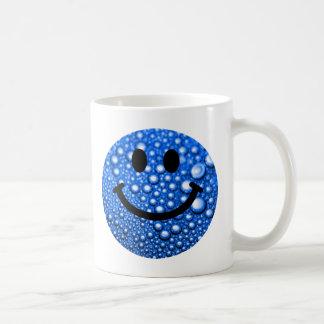 Gotitas de agua sonrientes tazas