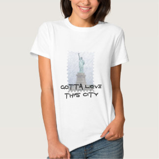 Gotta love this city - statues shirts