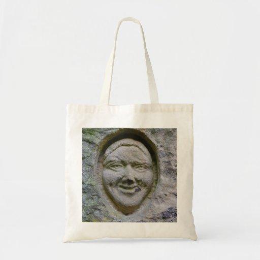 Grabado sonriente de la cara en la bolsa de asas d