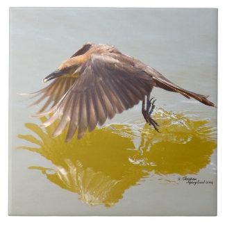 Graceful bird flying water Tile