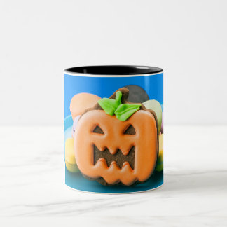 Graceful pumpkin surrounded by cakes Two-Tone coffee mug
