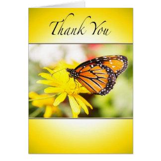 Gracias con la tarjeta anaranjada de la mariposa d