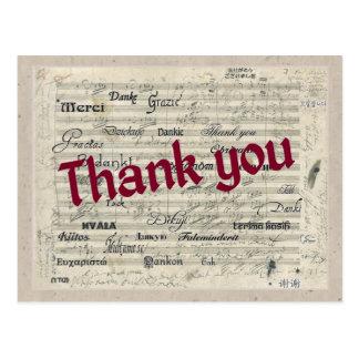 Gracias en muchas idiomas en la cuenta de postal