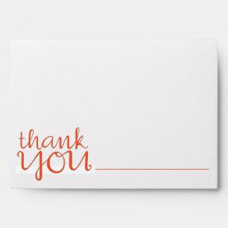 Gracias sobre cursivo de la tarjeta de nota de la