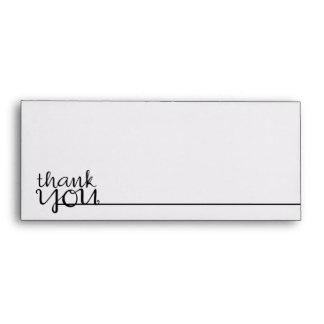 Gracias sobre cursivo del papel con membrete del n