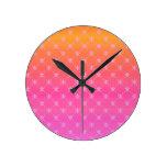 Gradient Pink and Orange Fleur de lis Wall Clocks