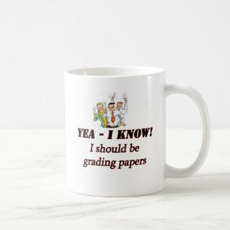 grading papers. coffee mugs