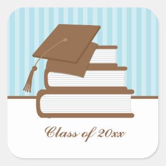 Graduación del casquillo y de los libros pegatina cuadrada