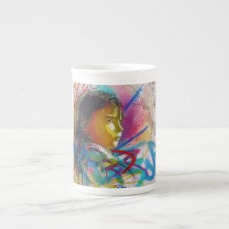 Graffiti Art of a Little Brunette Girl's Face Tea Cup