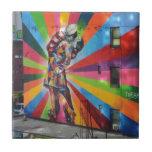 "Graffiti of New York Tile<br><div class=""desc"">Romantic,  nostalgic graffiti on an old building in New York. Sailor kisses girl in dancing shoes. Harlequin effect.</div>"
