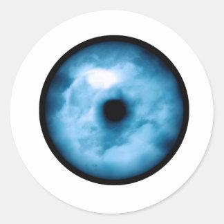 Gráfico nublado azul claro del ojo pegatina redonda