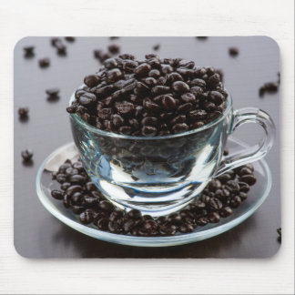 Grains of coffee in cup and crystal plate mouse pad