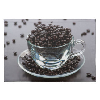 Grains of coffee in cup and crystal plate placemat