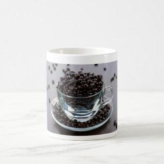 Grains of coffee in cup crystal. Jar