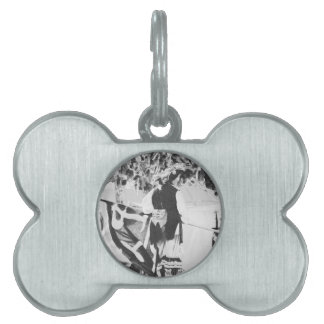 grainy woman taking down pirate flag pet tag