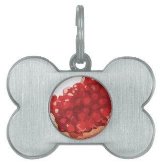 Granada abierta y deliciosa placas de mascota