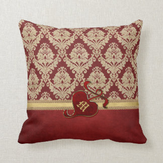 Granada antigua con monograma del rojo del oro del almohada