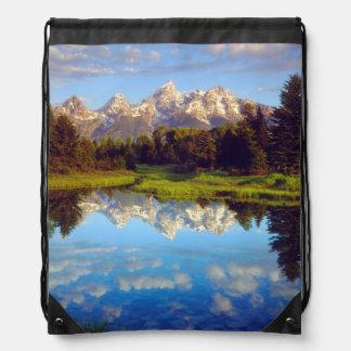 Grand Tetons reflecting in the Snake River Drawstring Backpack