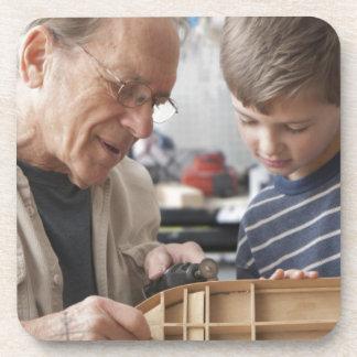 Grandfather And Grandson Work Together Beverage Coaster
