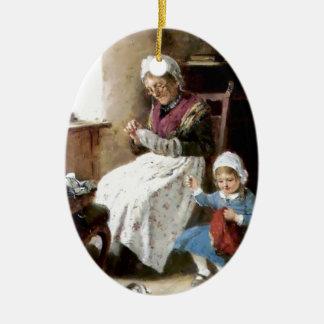 Grandmother and granddaughter sewing ceramic ornament