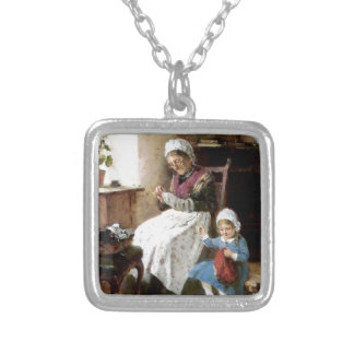 Grandmother and granddaughter sewing silver plated necklace