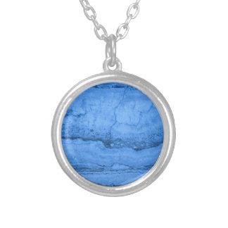 Granito azul collar plateado