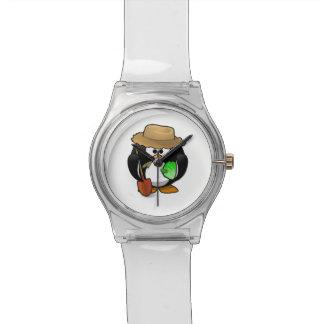 Granjero adorable del pingüino del dibujo animado reloj