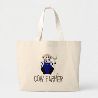 Granjero blanco y negro de la vaca de Brown de la  Bolsas
