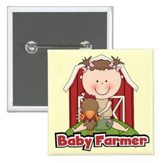Granjero de bebé con las camisetas y los regalos d pins