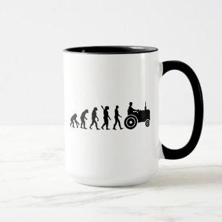 Granjero del tractor de la evolución
