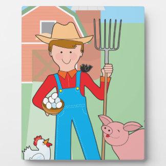 Granjero y cerdo placa de madera
