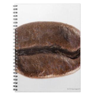 Grano de café de la carne asada, tiro del estudio cuadernos