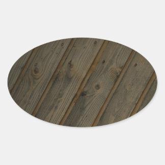 Grano de madera falso abstracto pegatina ovalada