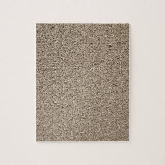Granular surface of the cement beige puzzle