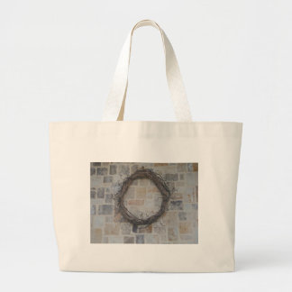 Grapevine Wreath on stone fireplace Tote Bag