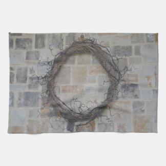 Grapevine Wreath on stone fireplace Kitchen Towel