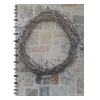 Grapevine Wreath on stone fireplace Note Books