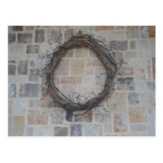 Grapevine Wreath on stone fireplace Postcard