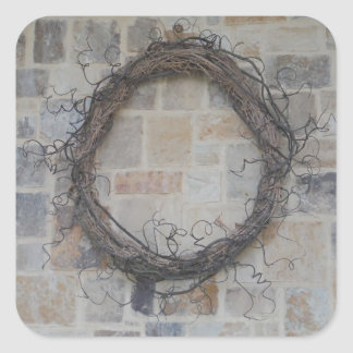 Grapevine Wreath on stone fireplace Square Stickers