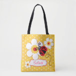 """Graphic ladybug flowers girls name tote bag<br><div class=""""desc"""">Pretty red, white and yellow flying ladybug / ladybird with daisy like flowers named print all over bag. Personalize with your own short name and choice of background color currently bright yellow. Name on bag presently reads Selina. Please note some names will not always fit due to the nature of...</div>"""