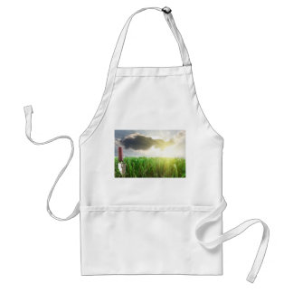 Grass and trowel on a sky and sunshine background adult apron