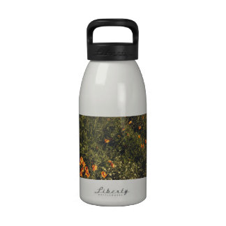 Grass Field With Wild Flowers and Poppies Water Bottle