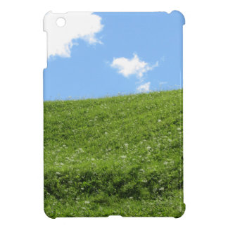 Grassy field at the rolling hill against the sky iPad mini covers