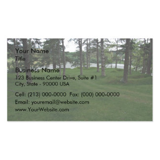 Grassy ground with trees and water business cards