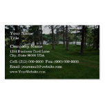Grassy ground with trees and water business card