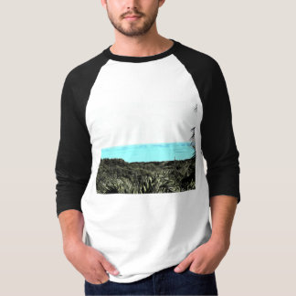 Grassy terrain leading to the water T-Shirt