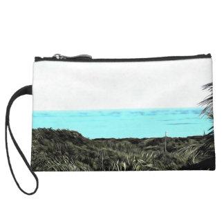 Grassy terrain near the water wristlet purse